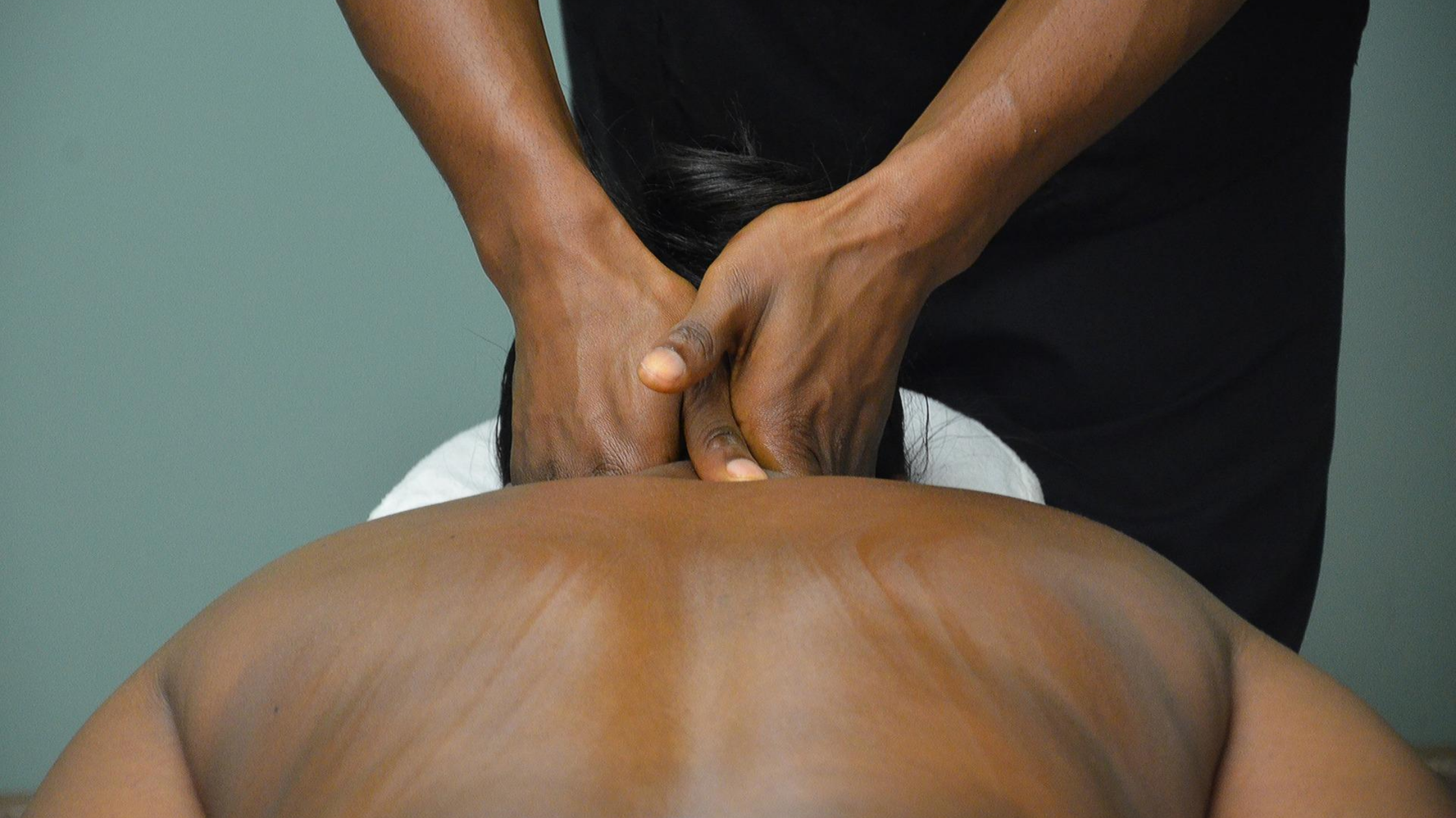 Hands massaging back and neck.