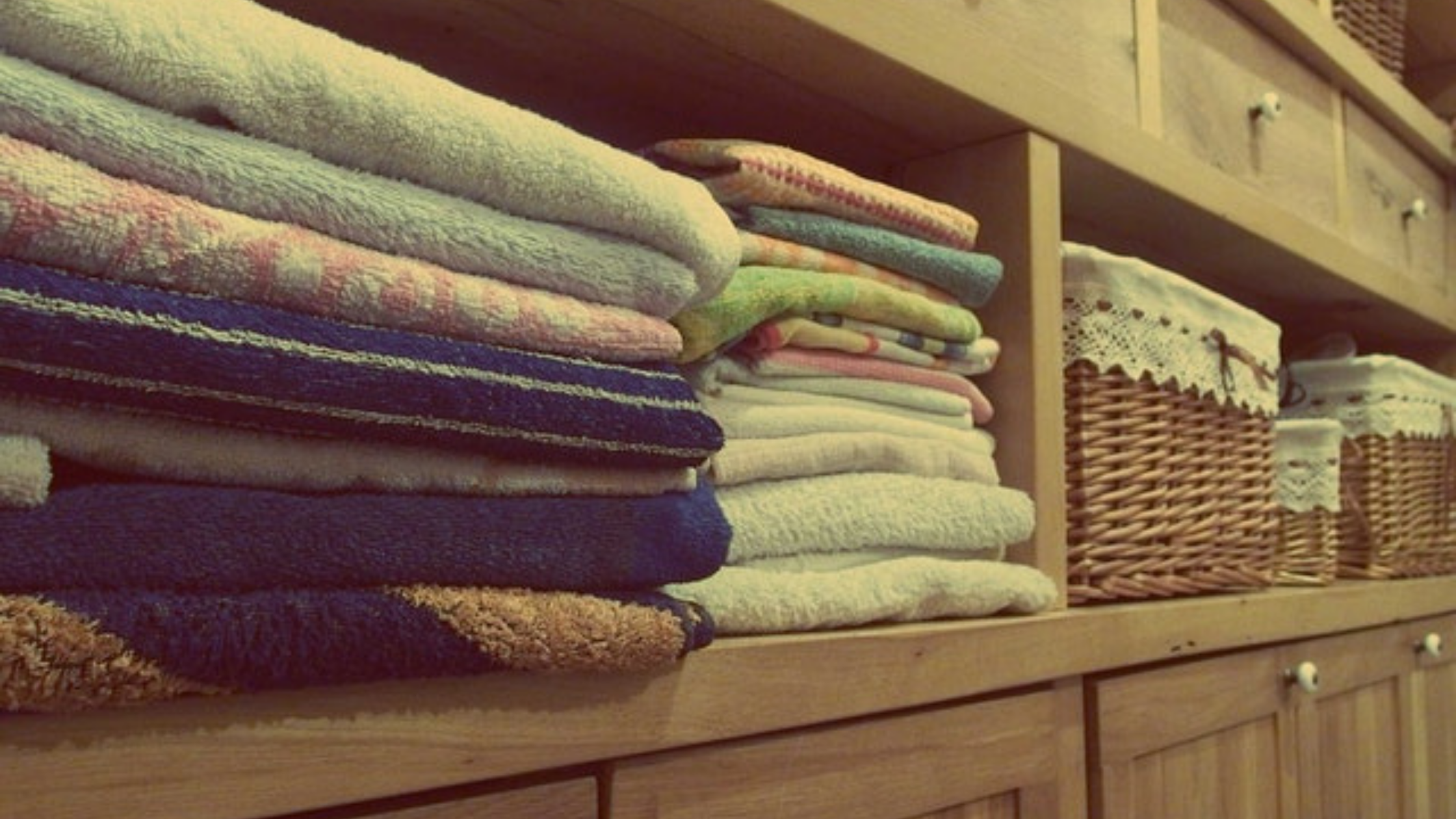 Organized towels with sliding basket drawers.
